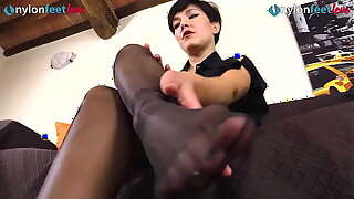 Tot in raven pantyhose takes boots off and shows feet